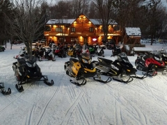 snowmobiles at the main lodge